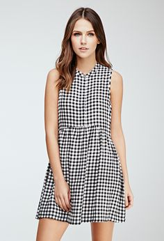 Easy, pretty, and perfectly polished thanks to a covered button placket, a punchy gingham print, and a sweet shirred skirt with a touch of sway
