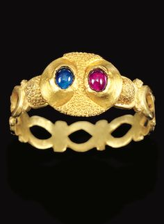 *ENGLISH, 14TH CENTURY RING gold set with a sapphire and a ruby   band: 18mm.,¾in. overall: 23mm., 7/8 in.
