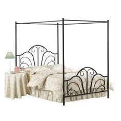 Canopy bed with a scrolling silhouette and matte finish. PERFECT FOR Shoots on the beach! <3  Scrollwork design