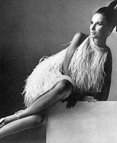 Brigitte Bauer in short dress of ostrich feathers and spangles by Laroche, photographed by Irving Penn for Vogue 1966. via rvision
