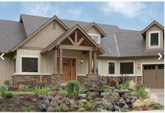 I like the stone work and the style of the front arch. Color of siding is too light.