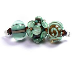3 petite lampwork glass round beads in shades of deep chocolate brown, espresso, copper green and pine.