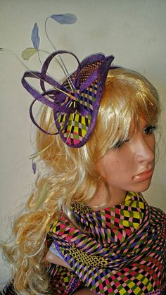 Check out this item in my Etsy shop https://www.etsy.com/listing/230438312/petiz-purple-african-print-fascinator