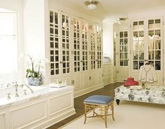 Large dressing room/closet/bathroom with blue and white palette, designed by James Radin