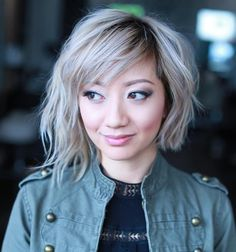 Wavy Asymmetrical Bob For Round Faces. wouldn't want the Asymmetrical, but i like the bangs.