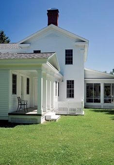 Greek Revival Farmhouse: The mudroom is accessed through a small porch complete with a pediment and square columns. [via oldhouseonline.com]