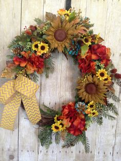 Front Door Wreath- Spring Door Wreath- Summer Door Wreath- Hydrangea Wreath- Sunflower Door Wreath- Burlap Sunflower Wreath- Outdoor Wreath    Year Round Wreath for Front Door with a twist. This warm and wonderful wreath is bursting with colorful shades of the season and trendy shades of Natural Burlap with Yellow Chevron Ribbon .Mixed varieties of warm toned foliage and pine is covered in multi colored and cream wild berries and set with the brilliant tones of red rust hydrangeas. Note the…