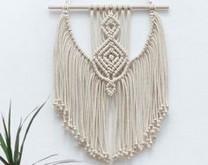 Beautiful macrame wall hanging. Modern design. Triangle Wall Art. So DELICATE and STYLISH!  Size: wooden stick: 40 cm (15,7'') width of woven: 30 cm (11,8'') length of woven – from top of wood to bottom of fringe: 71 cm (28'')  100% handmade NATURAL cotton cord  We ship WORLDWIDE! Shipping to Europe normally takes 5-8 days, to US, Canada – 7-15 days. Please feel free to contact me if you have any questions.  Thank you for visiting MOX macrame! To see similar my product click here…