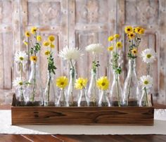 Glass Bottle Vase Runner Set | Kirklands  This would be easy to replicate with recycled bottles and pallet wood