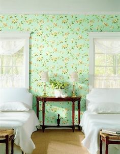 I didn't think I liked wallpaper, but this pattern, behind white and wood, is lovely.