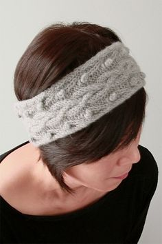 Free knitting pattern for Stephenie Ear Warmer - This headband combines classic cables and bobbles. Pattern includes written and charted instructions. Worsted weight yarn. Designed by Vicky Chan