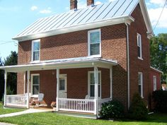Best Red Brick House With A White Standing Seam Metal Roof 400 x 300
