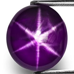 12.99-Carat Rare Deep Glossy Purple Star Sapphire from Sri Lanka,Gemstone : Natural Star Sapphire,Colour : Deep Glossy Purple,Clarity : Transparent (SI2),Grading : A (on a scale of A to E),Star Sharpness : Very Clearly Visible 6-Ray Star (Super Sharp),Origin : Ceylon (Sri Lanka),Mohs Hardness : 9 (On a Scale of 10),Treatments : None (Guaranteed Natural & Untreated)