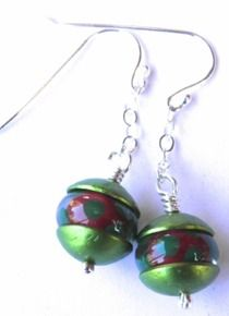 A pair of earrings featuring my handmade lampwork beads in red with green spots, capped in green anodised aluminium. Dangling from a soft sterling silver chain and finished in my handmade sterling silver ear wires. AU$40.00