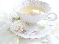 Teacup & saucer w/ a floral design and gold trim.