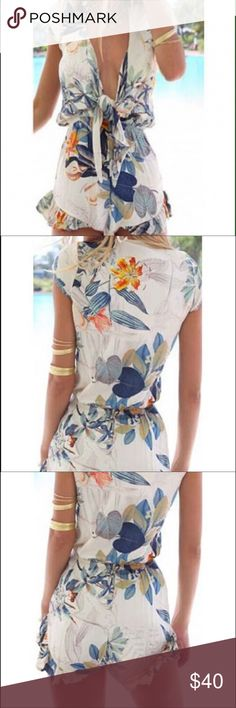 Floral tie front romper Re-posh -- SO cute on, I'm unfortunately a little too tall for it (I am 5'9) -- open to offers! It's a floral print, with tie front, would be a cute swimsuit cover up, or with a cute lace bralette and wedges! No brand or size tag, I wear smalls-medium and it fit everywhere great except the length! the waist is elastic so some room to stretch boutique Pants Jumpsuits & Rompers