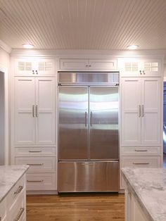 our finished kitchen reno white custom beaded inset cabinets super white quartzite counters