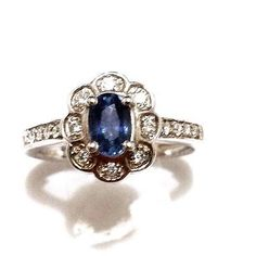 14k White Gold with .18CT Diamond, .50CT Sapphire Engagement Flower Ring