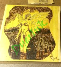 """This is """"Drelborne Surprise"""" - $175.00 - woodburned on osage yellow."""