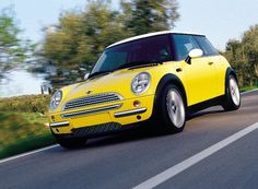 my DREAM car!!! a yellow mini cooper. (((:
