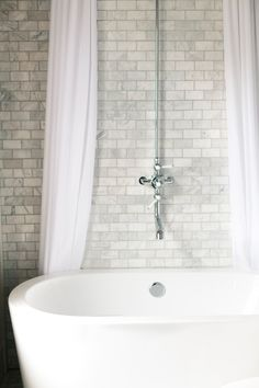 The subway tile with that tub is most excellent!