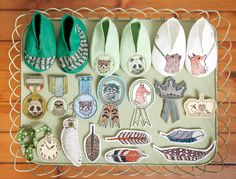 embroidered brooches and tiny shoes