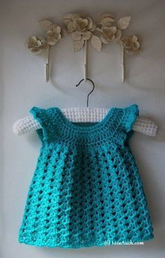 """<span class=""""caption_text"""">Beautiful Easy Crocheted Baby Dress</span>"""