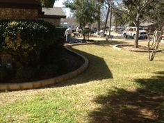 GroundScape, a Fort Worth Landscape Company, installs stone edging with mortar.