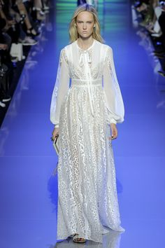 Elie Saab - The red carpet designer presents a fresh spin on '70s styling for disco-friendly brides.