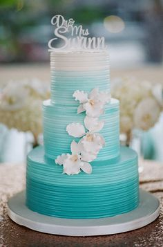 Aqua Ombre Wedding Cake with White Orchids | J Wilkinson Co Photography https://www.theknot.com/marketplace/j-wilkinson-co-photography-san-antonio-tx-224355 | Horseshoe Bay Resort https://www.theknot.com/marketplace/horseshoe-bay-resort-horseshoe-bay-tx-644362 | Simon Lee Bakery https://www.theknot.com/marketplace/simon-lee-bakery-austin-tx-234570