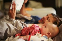 Look at that face!  Baby sure is engaged in the story.  Great picture; great job, dad.