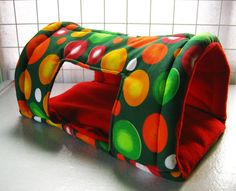 Colorful polka guinea pig tunnel bed by PinoyPetCuddleCup on Etsy, $10.00 I will hopefully be getting this for the pigs. They do love their tunnels.