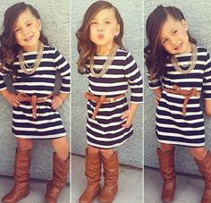 This girl is so cute. Love her boots and her dress!
