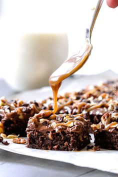 Poke Turtle Brownies seeping with pockets of caramel, infused with pecans and chocolate chips, smothered in the best chocolate frosting and topped with more caramel.