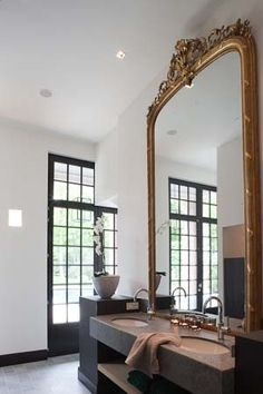 :: Havens South Designs :: loves this huge gilt mirror with a modern vanity.