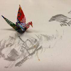 A folded-paper crane on a nice table napkin at a famous restaurant in Kyoto.