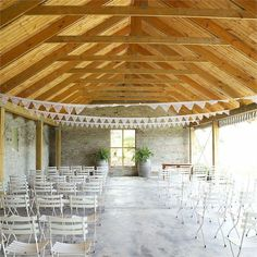 Natalie and Chris's wedding ceremony took place in the boathouse at Rockhaven. The gorgeous ceremony space was decorated with rustic lace bunting above rows of white garden chairs.The bride was walked down the aisle by her step father as her friend William from Willim Welsyn en die Sunrise Toffies played a rocking version of the 'Wedding March' on his electric guitar.