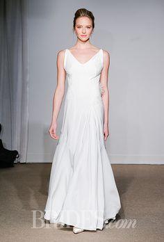 A V-neck Anna Maier ~ Ulla Maija wedding dress with feather detail | Brides.com