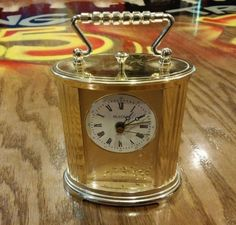 """product description this classic gold design decorative alarm clock made by bulova has a quartz movement. it measures 4"""" w x 1 1/2"""" d x 4 1/4""""h, and runs on battery. it runs on one (1) aa alkaline battery. it keeps excellent time, and the alarm works great. on the bottom of the clock it is stamped b1344 he 239, made in germany. the overall condition of this vinta"""