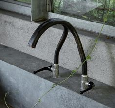 act_romegialli transformation of disused garage into garden pavilion, two pipes soldered into a faucet, Remodelista