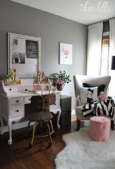 This sweet little vintage style pink desk and bunny ear chair add a whimsical touch to this pink black and gray girls room and fun accessories from HomeGoods add the finishing touches to the space. (sponsored pin)
