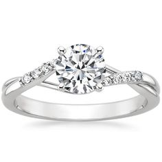 Love this one:-)!! From brilliant earth! This 18K White Gold Chamise Diamond Ring has a 0.71 carat Round shaped conflict free diamond with J-color, VVS2-clarity, and Super Ideal-cut.