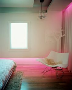 Furniture Photo - A molded-plastic rocking chair in a neutral bedroom