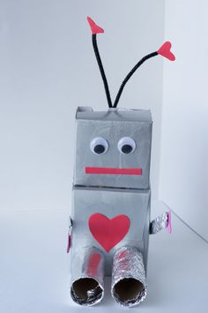 This cute robot craft makes an adorable Valentine Box for kids to collect their cards on Valentine's Day. - Creativity for this project is fueled by #Nesquik #ad