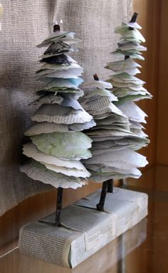 Library Display  Upcycle Book Page Trees - maybe host a contest for students to create their own trees