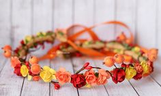 An unique Autumn Woodland flower crown in red, yellow and orange, with orange and red berries. Its perfect for Autumn weddings, flower girls or Photo prop. This lovely rustic crown is ideal for a country ot farmhouse wedding! Perfect fall hair wreath for brides, bridesmaids or flower girls.   Please NOTE, this is a HANDMADE crown and it may vary slightly from the picture you see.  The crown is over 25 cm (8) diameter and 55 cm long, Flexible, Open in the back for ribbon ties. The size is OK…