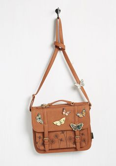 Floating lithely into the lecture hall with this faux-leather satchel over your shoulder, you're ready to take on the class discussion. There's no need to 'wing' it, because your tan, butterfly applique-adorned bag - a whimsical offering by Disaster Designs - is packed with tutorial materials to fuel your academic curiosities! (affiliate link)