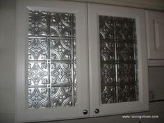Update glass in kitchen cupboard doors using backsplash tiles!
