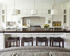 white cabinets. island.