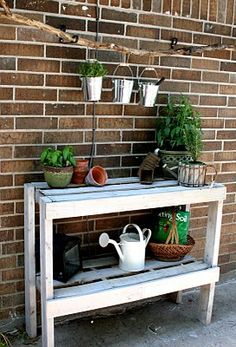 A simple, functional, potting bench built using an old wooden crate.  Made by Jillian, writer of a blog called The Virginia House: Your Home is What you Make it.
